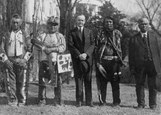 Pres. Calvin Coolidge and four Osage Indians at the White House, June 2, 1924