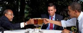 Henry Louis Gates Jr. (1950-) et al. drink beer with Pres. Obama