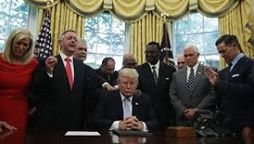 Pres. Trump praying with evangelicals in White House